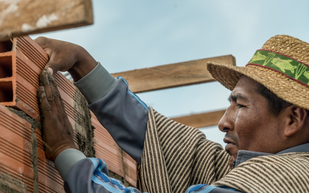 Cemiano and his brother, Luis Valero work as bricklayer for an Aymara family.
