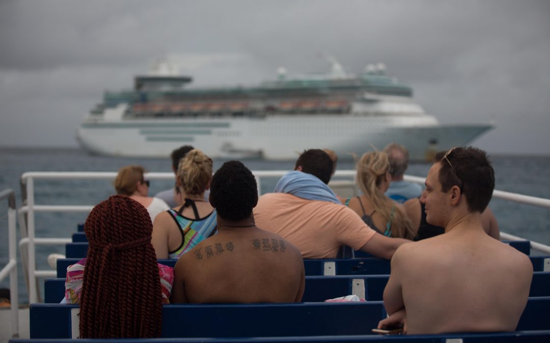 Passengers return to their cruise ship after a one-day excursion to Coco Cay, a Bahamas island privately run by Royal Caribbean. Almudena Toral/Univision.