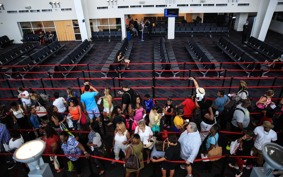 Dozens of passengers wait in the port of Miami to board a weekend Carnival cruise. More than 18.4 million passengers vacationed in 2015 with the industry's three biggest companies: Carnival, Royal Caribbean and Norwegian. Almudena Toral/Univision.