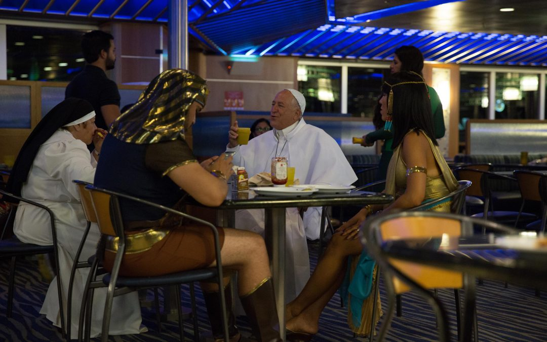 Passengers at a Halloween party during an ocean cruise, dressed as a pope, a nun, Cleopatra and an Egyptian. Almudena Toral/Univision
