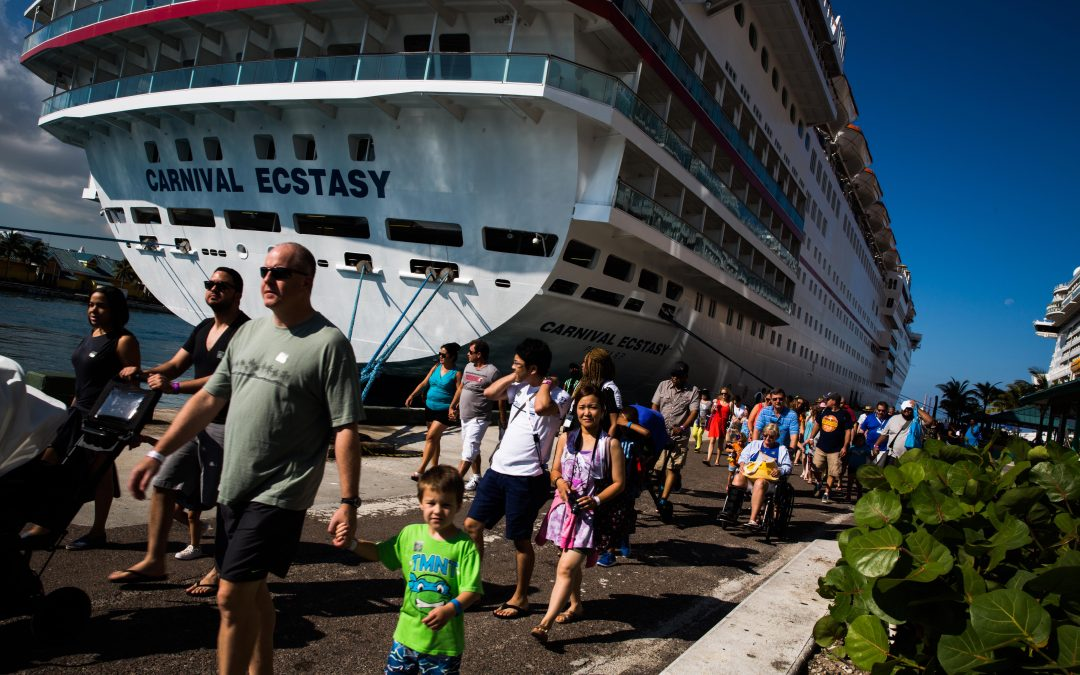 Passengers disembark from the Carnival Ecstasy cruise ship in Nassau, Bahamas. Almudena Toral/Univision